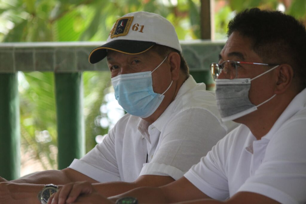Casiguran Mayor Edwin Hamor, Sorsogon COVID-19 Task force Chairman (left) and Sorsogon Vice Governor Manuel Fortes holds dialogue with local and barangay officials in Bulusan town. Bicol Express News photo